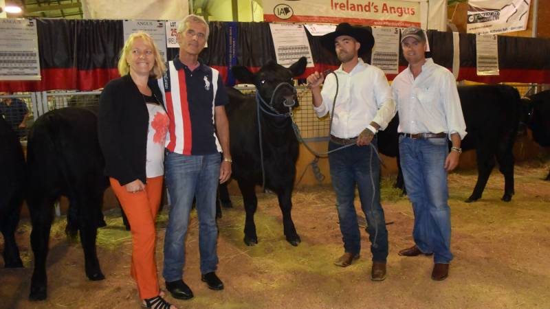 Helma and Henk Van Den Heuvel with their top sale purchase Irelands Eclypta L327, bought for $29,000, with Mitchell Ray and Corey Ireland of Ireland's Angus, Wagga Wagga.